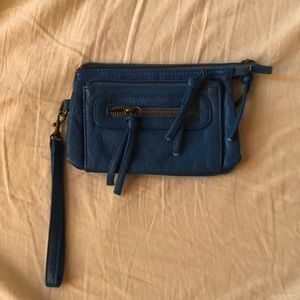 Small blue clutch that widens!